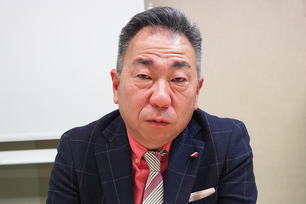 エイコムとアーツエイハンの代表取締役を務める飯塚吉純さん